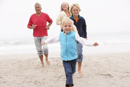 grandddaughter: Grandparents And Grandchildren Running On Winter Beach Together