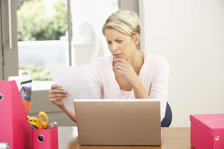 Woman Using Laptop At Home photo
