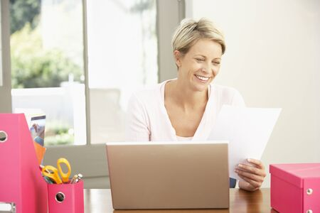 Woman Using Laptop At Home Stock Photo - 8476387