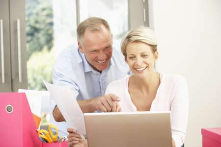 Couple Using Laptop At Home Stock Photo - 8482792