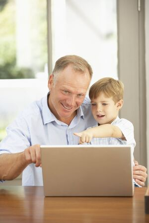 Father And Son Using Laptop At Home Stock Photo - 8482852