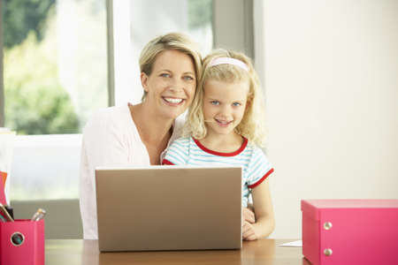 silver surfer: Mother And Daughter Using Laptop At Home