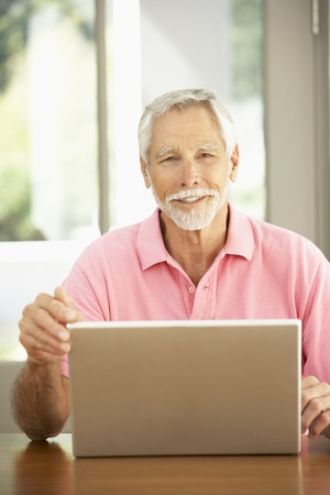 Senior Man Using Laptop At Home Stock Photo - 8482876