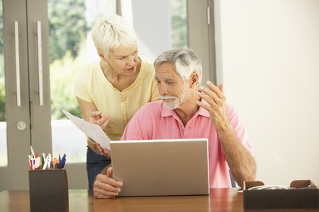 Worried Senior Couple Using Laptop At Home Stock Photo - 8482858