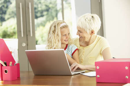 Granddaughter And Grandmother Using Laptop At Home Stock Photo - 8482851