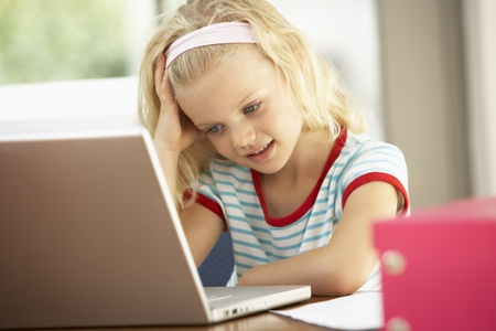 Young Girl Using Laptop At Home Stock Photo - 8482871