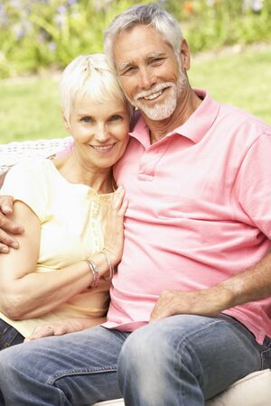 mature couple: Senior Couple Relaxing In Garden
