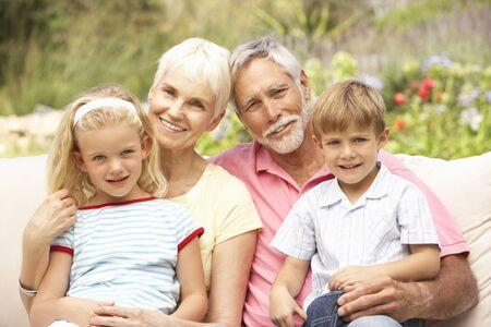 Grandparents And Grandchildren Relaxing In Garden Stock Photo - 8483026