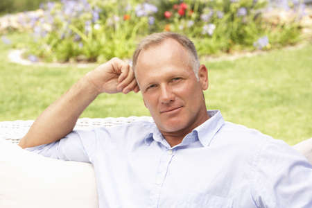 middleaged man: Middle Aged Man Relaxing In Garden
