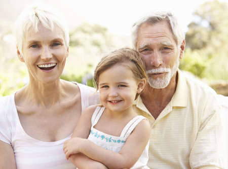 Grandparents And Granddaughter Relaxing In Garden Stock Photo - 8482822
