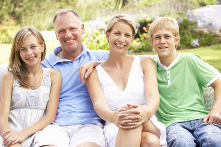 Family Relaxing In Garden Stock Photo - 8483121