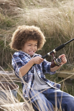 7 year old boys: Young Boy Fishing At Seaside