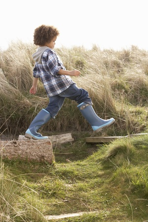 7 year old boys: Young Boy Going For Walk In Wellington Boots