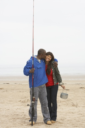 20 year old: Couple Fishing On Beach