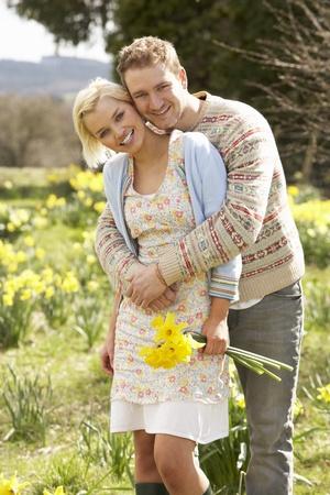 amongst: Romantic Couple Walking Amongst Spring Daffodils