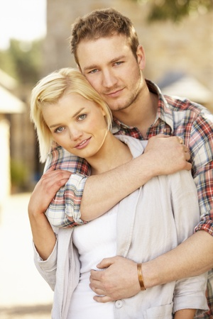 embracing couple: Portrait Of Romantic Young Couple Embracing Stock Photo