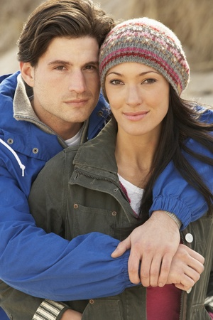 winter couple: Romantic Young Couple On Winter Beach