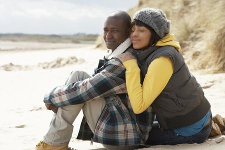 couples hug: Romantic Young Couple On Winter Beach