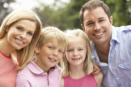 Portrait Of Family Relaxing In Countryside Stock Photo
