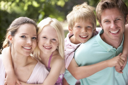 Family Having Fun In Countryside Together Stock Photo
