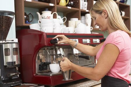 Woman Making Coffee In Café