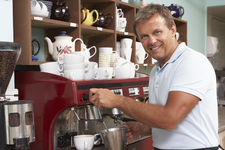Man Making Coffee In Café