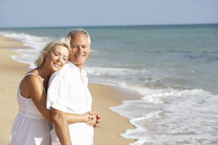 loving couples: Senior Couple Enjoying Beach Holiday Stock Photo