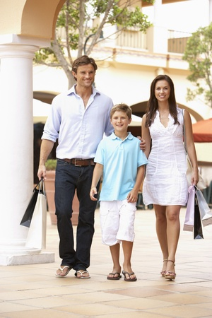 nine years old: Young Family Enjoying Shopping Trip Together Stock Photo