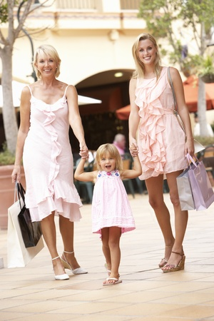 3 4 length: Grandmother, Mother And Daughter Enjoying Shopping Trip Together Stock Photo