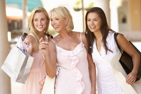 grown ups: Senior Mother And Daughters Enjoying Shopping Trip Together