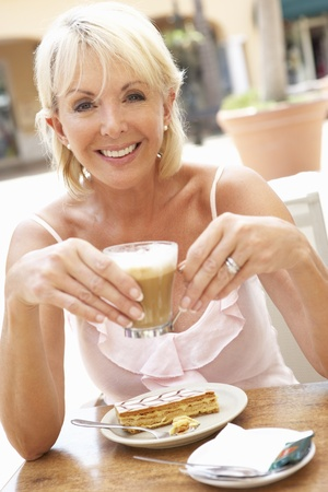 hot drink: Senior Woman Enjoying Coffee And Cake In Caf?