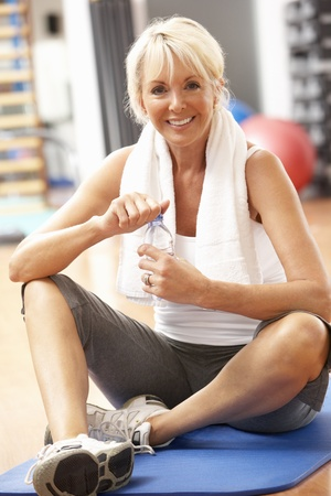 the sixties: Senior Woman Resting After Exercises In Gym