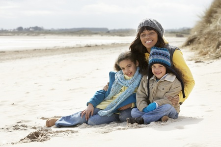 Mother And Children On Winter Beach