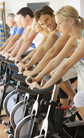 Man Cycling In Spinning Class In Gym photo