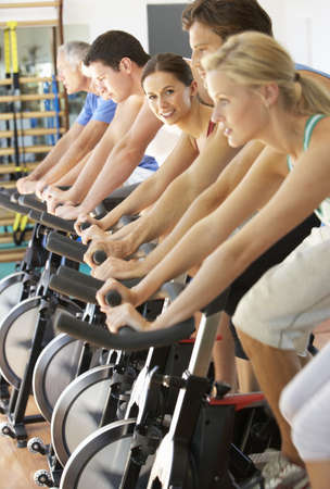 spinning: Woman Cycling In Spinning Class In Gym
