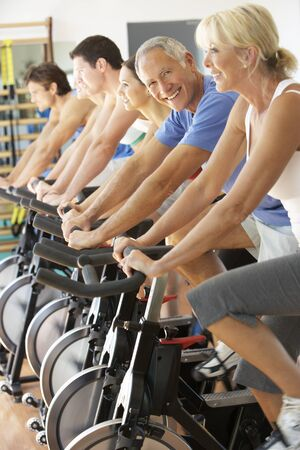 gym class: Senior Man Cycling In Spinning Class In Gym