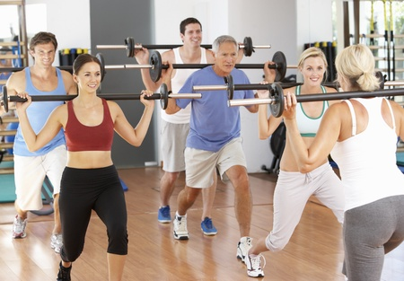 Group Of People Lifting Weights In Gym photo