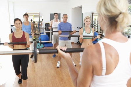 Group Of People Lifting Weights In Gym Stock Photo - 8505095