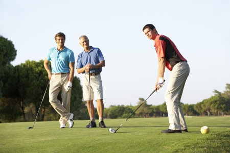 8510123: Group Of Male Golfers Teeing Off On Golf Course Stock Photo