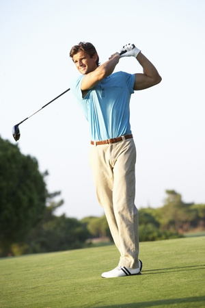 Male Golfer Teeing Off On Golf Course Stock Photo - 8503509
