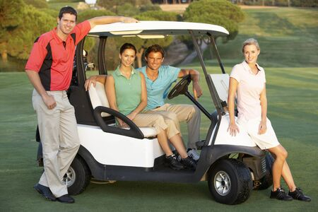 playing golf: Group Of Friends Riding In Golf Buggy On Golf Course Stock Photo