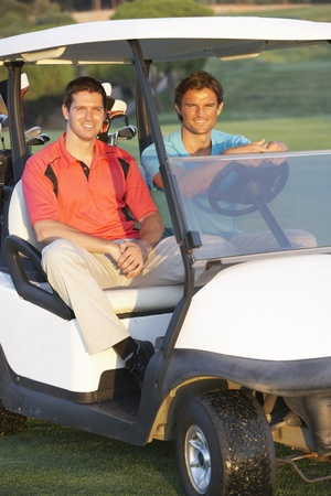 8513907: Two Male Golfers Riding In Golf Buggy On Golf Course Stock Photo