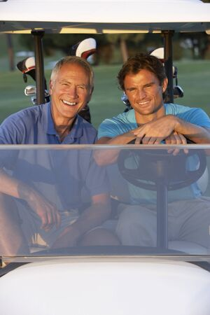 Two Male Golfers Riding In Golf Buggy On Golf Course Stock Photo - 8510119