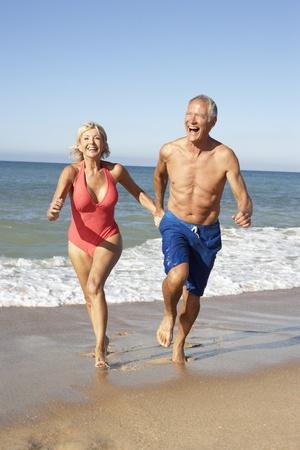 Senior Couple Enjoying Beach Holiday photo