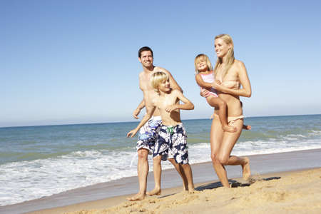 guy on beach: Portrait Of Family On Summer Beach Holiday Stock Photo