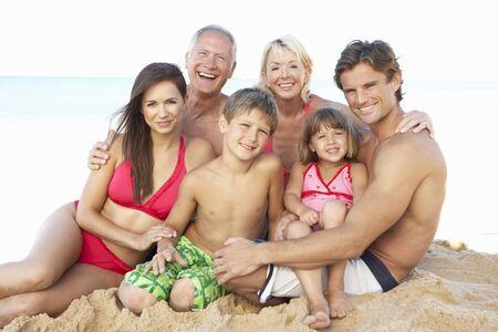 Portrait Of Three Generation Family On Beach Holiday photo