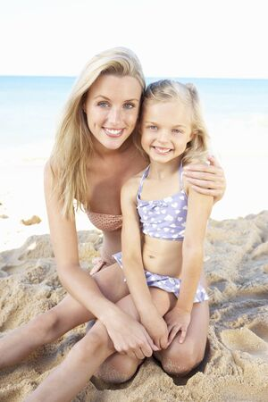 Portrait Of Mother And Daughter On Summer Beach Holiday photo