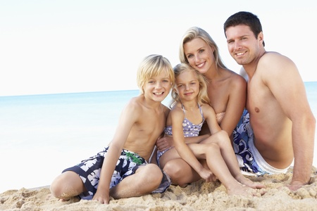Portrait Of Family On Summer Beach Holiday photo