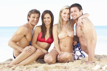 Group Of Friends Enjoying Beach Holiday photo