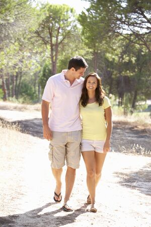 Young couple, holding hands, walking,walk in park photo